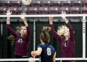 Charlie Kaijo/NWA Democrat-Gazette Siloam Springs blockers Rachel Conrad, left, and Ellie Lampton attempt to stuff the kill attempt of Greenwood's Abby Cagle during Thursday's 5A-West Conference match inside Panther Activity Center. Greenwood defeated Siloam Springs 3-0.