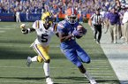 Florida wide receiver Josh Hammond, right, catches a 35-yard pass in front of LSU cornerback Kary Vincent Jr., left, to set up a Florida touchdown during the first half of an NCAA college football game, Saturday, Oct. 6, 2018, in Gainesville, Fla. (AP Photo/John Raoux)