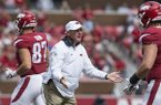 Arkansas coach Chad Morris greets players on the sideline during a game against Alabama on Saturday, Oct. 6, 2018, at Razorback Stadium in Fayetteville.