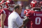 Arkansas defensive coordinator John Chavis talks to players during a game against Alabama on Saturday, Oct. 6, 2018, in Fayetteville.