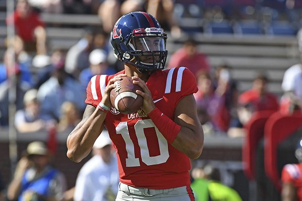 Ole Miss quarterback Jordan Ta'amu (10) looks to pass during the first half of an NCAA college football game against Louisiana Monroe in Oxford, Miss., Saturday, Oct. 6, 2018. (AP Photo/Thomas Graning)