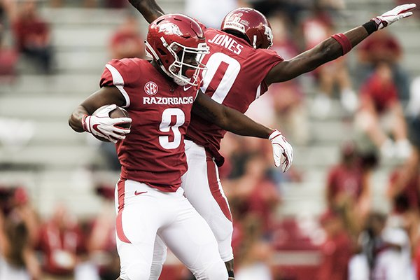 Arkansas wide receiver De'Vion Warren (9) reacts after scoring a touchdown during the fourth quarter of a football game against Alabama on Saturday, Oct. 6, 2018, at Donald W. Reynolds Razorback Stadium in Fayetteville.