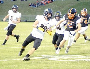 RANDY MOLL NWA NEWSPAPERS Prairie Grove senior Garrett Heltemes carries the football during first quarter at Gravette. Heltemes scored twice on short runs against Shiloh Christian, but the Tigers were routed 56-14 Friday.
