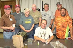 Photo submitted Pictured are a few of the members of the advanced fly-tyers class: Richard Starr (left), Marvin Macedo, Beth Armour, Steve Curtis, Jim Hudson, Gary Henderson and Mike Mullenix. The advanced class is taught by club member Dave Barfield (seated).