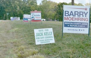 Keith Bryant/The Weekly Vista Campaign signs are sprouting up all over Bella Vista.