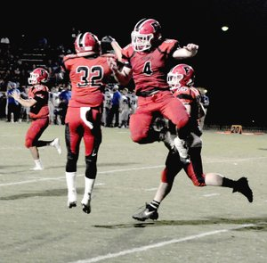MARK HUMPHREY ENTERPRISE-LEADER Farmington seniors: tailback Reid Turner (left) and fullback Rhett Rominger celebrate Rominger's 1-yard touchdown plunge. The Cardinals were defeated, 28-14, in their Homecoming game by Greenbrier on Friday, Oct. 5, 2018.