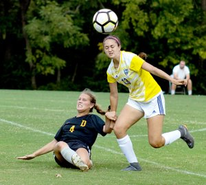 Photo courtesy of JBU Sports Information John Brown sophomore defender Audrey Balafas, right, battles Science and Arts (Okla.) defender Grace Schmidt for the ball during Saturday's match at Alumni Field. The Drovers defeated the Golden Eagles 2-1.