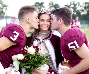 Westside Eagle Observer/RANDY MOLL Homecoming captains Peyton Wright and Garrett Hays kiss queen Danielle Spencer on the cheek at homecoming ceremonies at Gentry High School on Friday, Oct. 5, 2018.