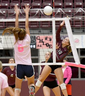 Bud Sullins/Special to the Herald-Leader Siloam Springs senior Katie Kendrick goes up for a hit as Shiloh Christian's Kaylee Jackson tries to block during Monday's volleyball match inside the Panther Activity Center.