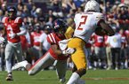 Mississippi defensive back Myles Hartsfield (15) tackles Louisiana Monroe wide receiver R.J. Turner (2) during the first half of an NCAA college football game in Oxford, Miss., Saturday, Oct. 6, 2018. (AP Photo/Thomas Graning)