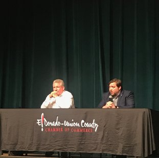 Incumbent Union County Judge Mike Loftin, a Democrat, at left, and opponent Cliff Preston, a Republican, at right, answer questions Tuesday at a public forum at the El Dorado Municipal Auditorium.
