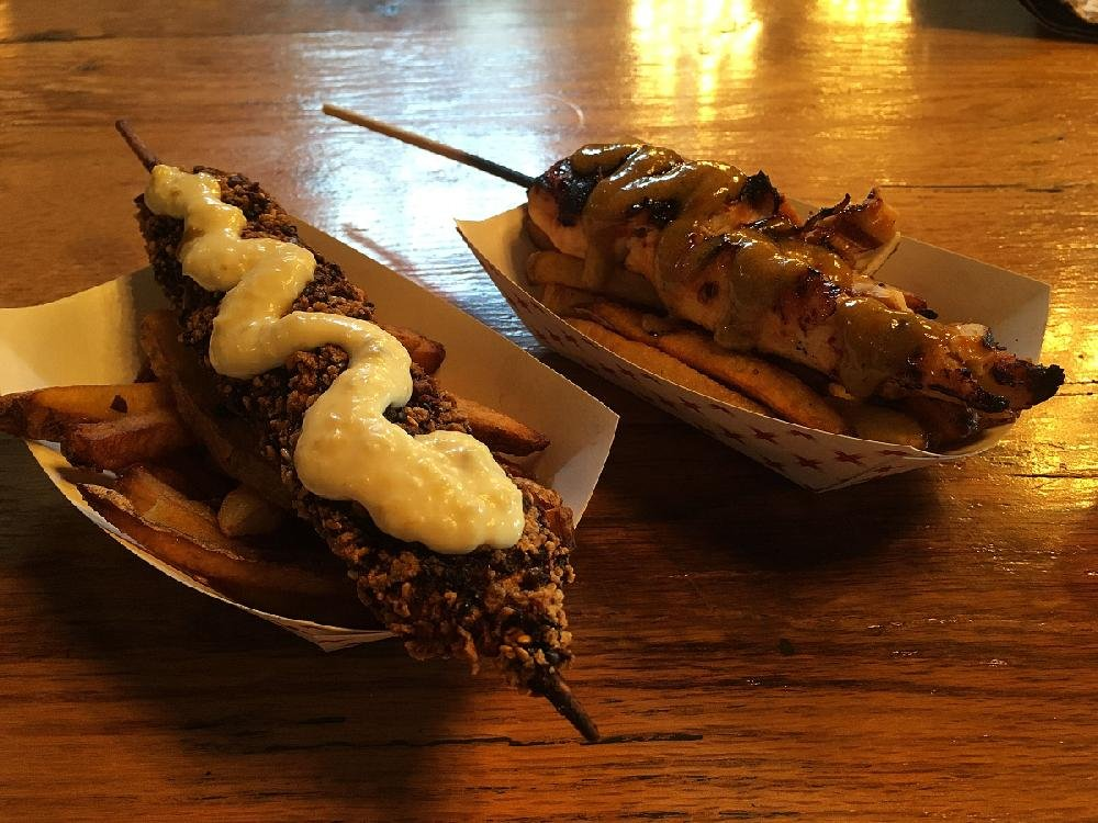 """Food on Sticks"" — including Sesame Crusted Pork (left) and Thai Chicken Satay — Live Life Chill rises above ordinary bar food and toward uniqueness."