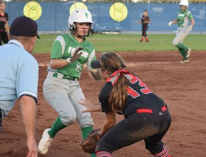 RICK PECK/SPECIAL TO MCDONALD COUNTY PRESS McDonald County third baseman Whitney Kinser tries to dodge Makenna Kliethermes of Blair Oaks to catch a throw during the Lady Mustangs' 10-3 loss at the 19th Annual Carthage Softball Invitational.