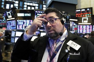 Trader Michael Capolino works on the floor of the New York Stock Exchange on Thursday. The market's recent decline was set off by a sharp drop in bond prices and a corresponding increase in yields last week and early this week. (AP Photo/Richard Drew)