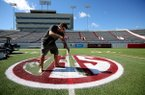 Josh Oliver paints the SEC logo on the field at War Memorial Stadium on Wednesday, Oct. 10, 2018, in Little Rock, in preparation for Saturday's football game between Arkansas and Ole Miss. As part of the new security measures for War Memorial Stadium no purses or backpacks are allowed, only clear bags, walk-through metal detectors and security wands will be at all entrances, and there is a prohibition against loitering in the concourse. The stadium opens at 4 p.m. and kickoff is scheduled for 6:30 p.m.