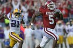Arkansas running back Darren McFadden outruns LSU defensive back Chevis Jackson for an 80-yard touchdown during the fourth quarter of a game Friday, Nov. 24, 2006, in Little Rock. McFadden broke Madre Hill's single-season school rushing record on the play.