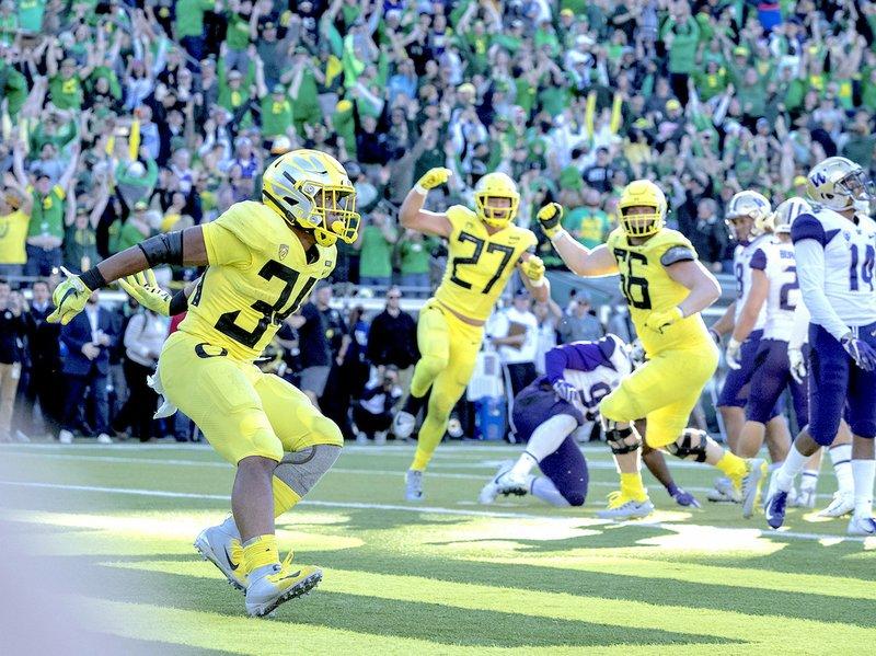 Oregon Outlasts Washington In Top 25 Matchup