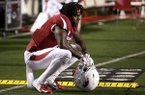 Arkansas wide receiver La'Michael Pettway (16) kneels on the sideline after the Razorbacks' 37-33 loss to Ole Miss on Saturday, Oct. 13, 2018, at War Memorial Stadium in Little Rock.