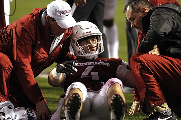 Arkansas quarterback Ty Storey (4) is tended to by trainers during the fourth quarter of the Razorbacks' 37-33 loss to Ole Miss on Saturday, Oct. 13, 2018, at War Memorial Stadium in Little Rock.