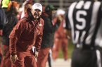Arkansas coach Chad Morris talks with the officials after a penalty in the first half of an NCAA college football game Saturday, Oct. 13, 2018, in Little Rock, Ark. (AP Photo/Michael Woods)