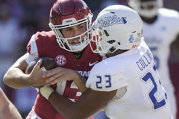 Arkansas quarterback Connor Noland is hit by Tulsa linebacker Zaven Collins during a game Saturday, Oct. 20, 2018, in Fayetteville.