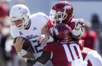 Arkansas defenders tackle Tulsa quarterback Seth Boomer (12) during the second quarter of a football game, Saturday, October 20, 2018 at Donald W. Reynolds Razorback Stadium in Fayetteville.