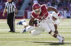 Arkansas running back Rakeem Boyd tries to run out of a tackle attempt by a Tulsa defender during a game Saturday, Oct. 20, 2018, in Fayetteville.