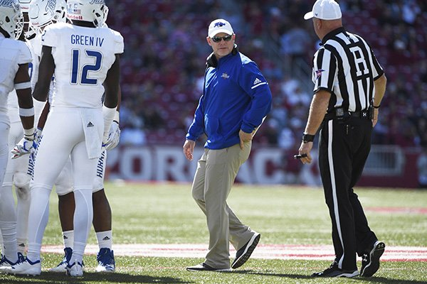 Tulsa coach Philip Montgomery talks to an official during the second half of an NCAA college football game against Arkansas, Saturday, Oct. 20, 2018, in Fayetteville, Ark. (AP Photo/Michael Woods)