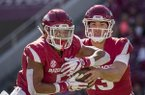 Arkansas quarterback Connor Noland (right) fakes a handoff to running back Rakeem Boyd during a game against Tulsa on Saturday, Oct. 20, 2018, in Fayetteville.