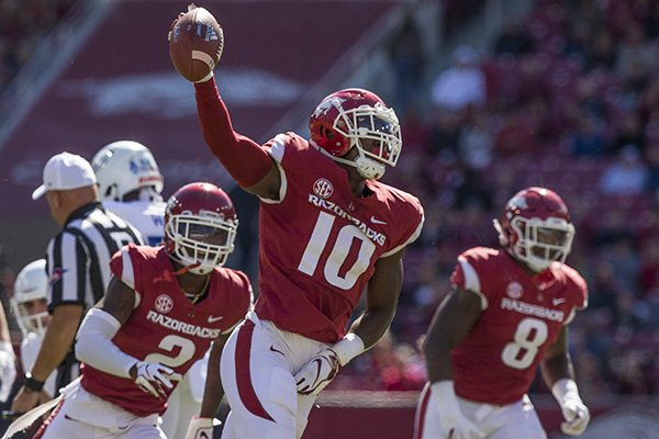 Arkansas defensive lineman Randy Ramsey (10) runs off the field with the ball after recovering a fumble during a game against Tulsa on Saturday, Oct. 20, 2018, in Fayetteville.