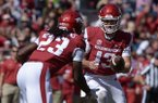 Arkansas quarterback Connor Noland hands the ball to running back Maleek Williams (23) during a game Saturday, Oct. 20, 2018, in Fayetteville.