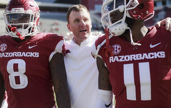 Arkansas Razorbacks head coach Chad Morris embraces his players at the end of a football game, Saturday, October 20, 2018 at Donald W. Reynolds Razorback Stadium in Fayetteville. The Arkansas Razorbacks blow out Tulsa 23-0 to break a six game losing streak.