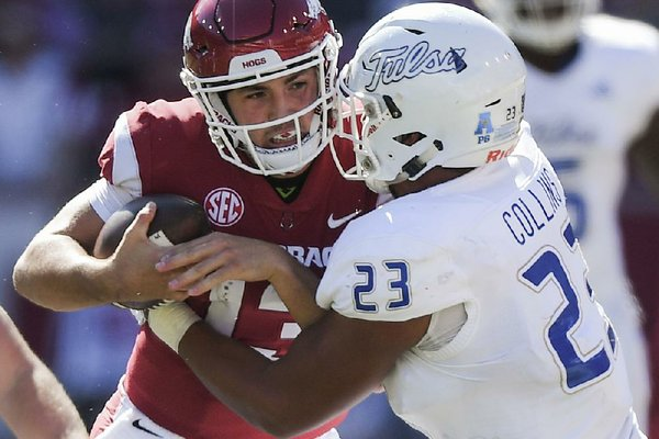 NWA Democrat-Gazette/CHARLIE KAIJO Arkansas Razorbacks quarterback Connor Noland (13) carries the ball as Tulsa Golden Hurricane linebacker Zaven Collins (23) tackles during the second quarter of a football game, Saturday, October 20, 2018 at Donald W. Reynolds Razorback Stadium in Fayetteville.