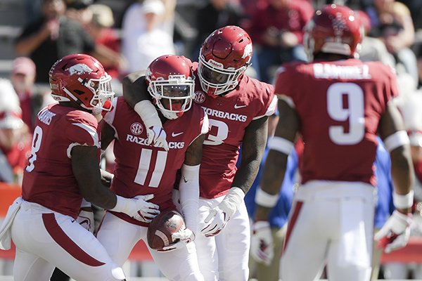 Arkansas Razorbacks defensive back Ryan Pulley (11) reacts after intercepting a pass intended for Tulsa Golden Hurricane wide receiver Keylon Stokes (2) during the second quarter of a football game, Saturday, October 20, 2018 at Donald W. Reynolds Razorback Stadium in Fayetteville.