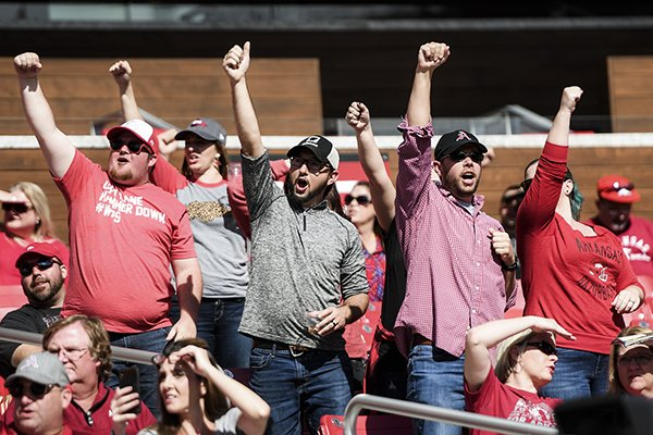 Arkansas Razorbacks fans call the hogs during the fourth quarter of a football game, Saturday, October 20, 2018 at Donald W. Reynolds Razorback Stadium in Fayetteville.