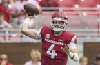 Ty Storey, Arkansas quarterback, gets off a pass as he takes a hit from Christian Miller, Alabama linebacker, in the 1st quarter Saturday, Oct. 6, 2018, at Razorback Stadium in Fayetteville.