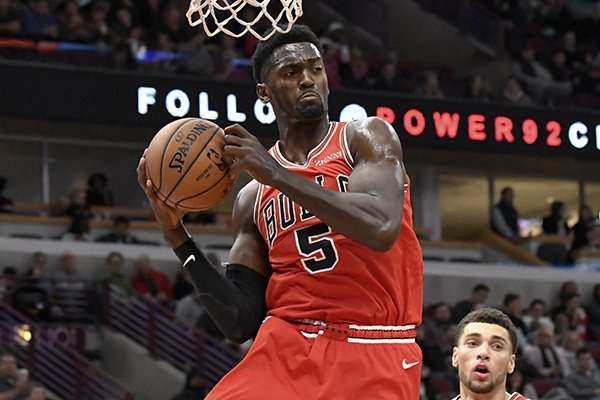 Chicago Bulls forward Bobby Portis (5) grabs a rebound against the Charlotte Hornets during the second half of a NBA basketball game Wednesday, Oct. 24, 2018, in Chicago. The Bulls won 112-110. (AP Photo/David Banks)