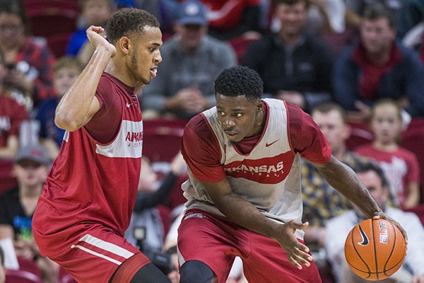 Arkansas center Daniel Gafford guards forward Adrio Bailey during the Red-White exhibition game on Friday, Oct. 19, 2018, in Fayetteville.