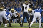 Vanderbilt quarterback Kyle Shurmur (14) stands at the line of scrimmage during the first half of an NCAA college football game against Kentucky in Lexington, Ky., Saturday, Oct. 20, 2018. (AP Photo/Bryan Woolston)