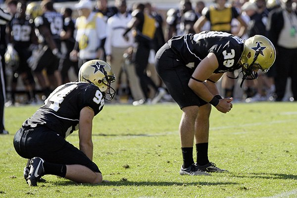 Vanderbilt kicker Carey Spear (39) and holder Richard Kent (94) pause on the field after Spear missed a 27-yard field goal attempt to tie the game against Arkansas with 8 seconds left in the fourth quarter of an NCAA college football game on Saturday, Oct. 29, 2011, in Nashville, Tenn. Arkansas won 31-28. (AP Photo/Mark Humphrey)