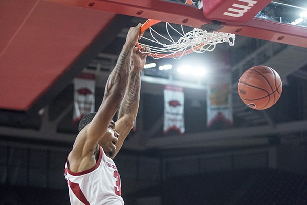Reggie Chaney of Arkansas dunks in the first half vs Tusculum Friday, Oct. 26, 2018, during an exhibition game in Bud Walton Arena in Fayetteville.