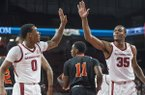 Desi Sills (0) and Reggie Chaney of Arkansas high five after a play in the first half vs Tusculum Friday, Oct. 26, 2018, during an exhibition game in Bud Walton Arena in Fayetteville.