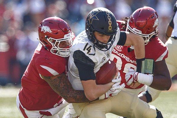 Arkansas defensive linemen Briston Guidry and Armon Watts sack Vanderbilt quarterback Kyle Shurmur during a game Saturday, Oct. 27, 2018, in Fayetteville.
