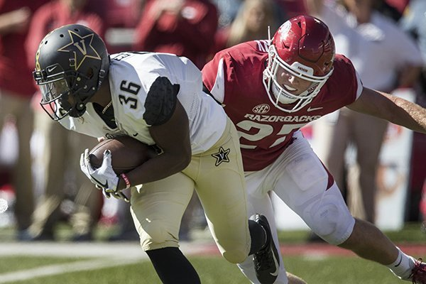 Vanderbilt receiver Trey Ellis is pursued by Arkansas linebacker Hayden Henry during a game Saturday, Oct. 27, 2018, in Fayetteville.