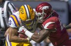 Dre Greenlaw, Arkansas linebacker, tackles Derrius Guice, LSU running back, in the first quarter Saturday, Nov. 11, 2017 at Tiger Stadium in Baton Rouge, La.