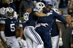 BYU coach Kalani Sitake celebrates with defensive back Austin Lee (11) after Lee intercepted a Hawaii pass during an NCAA college football game Saturday, Oct. 13, in Provo, Utah. (Isaac Hale/Daily Herald via AP)