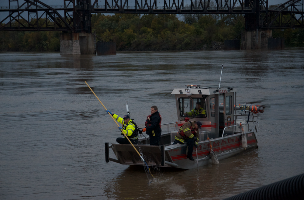 Crews searched the Arkansas River Thursday afternoon for the body of a man who crashed in the westbound lane of I-30, ran to the North River Landing pier and jumped in the water.
