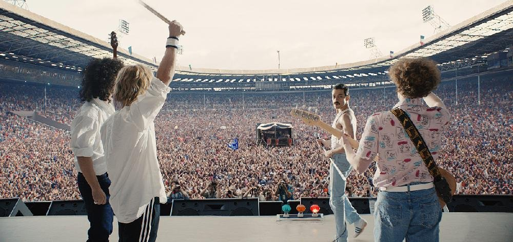 Members of the rock band Queen (from left) Brian May (Gwilym Lee), Roger Taylor (Ben Hardy), Freddie Mercuty (Rami Malek) and John Deacon (Joe Mazzello) re-unite to play the Live Aid benefit at London's Wembley Stadium on July 13, 1985, in Bohemian Rhapsody.