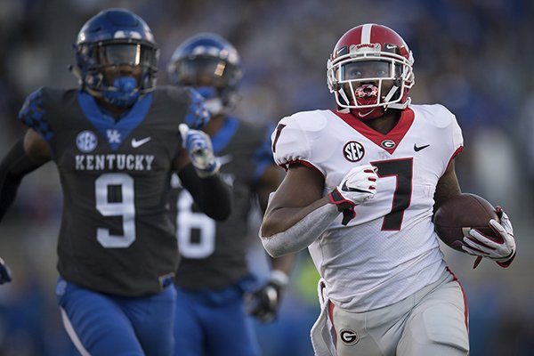 Georgia running back D'Andre Swift (7) runs for a touchdown during the second half an NCAA college football game against Kentucky in Lexington, Ky., Saturday, Nov. 3, 2018. (AP Photo/Bryan Woolston)