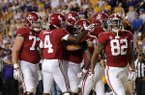 Alabama wide receiver Henry Ruggs III (11) celebrates his touchdown reception with teammates in the first half of an NCAA college football game against LSU in Baton Rouge, La., Saturday, Nov. 3, 2018. (AP Photo/Gerald Herbert)
